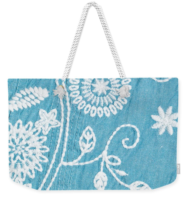 Backgrounds Weekender Tote Bag featuring the photograph Embroidery by Tom Gowanlock