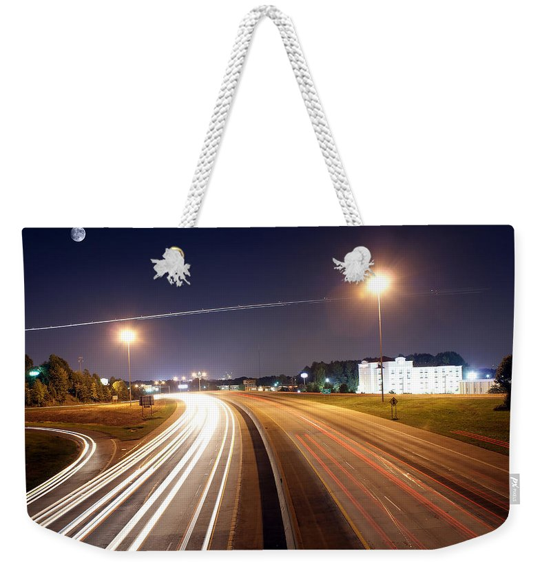 District Weekender Tote Bag featuring the photograph Evening Traffic On Highway by Alex Grichenko