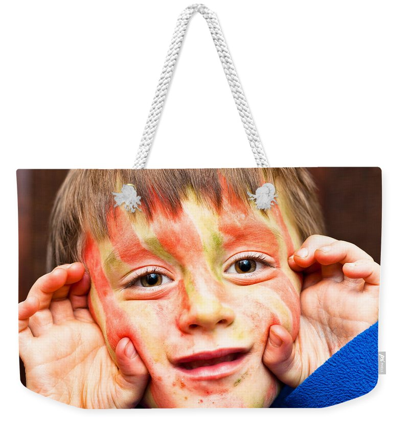 Adorable Weekender Tote Bag featuring the photograph Face Paint by Tom Gowanlock