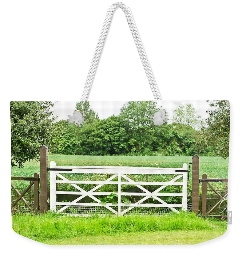 Access Weekender Tote Bag featuring the photograph Farm Gate by Tom Gowanlock