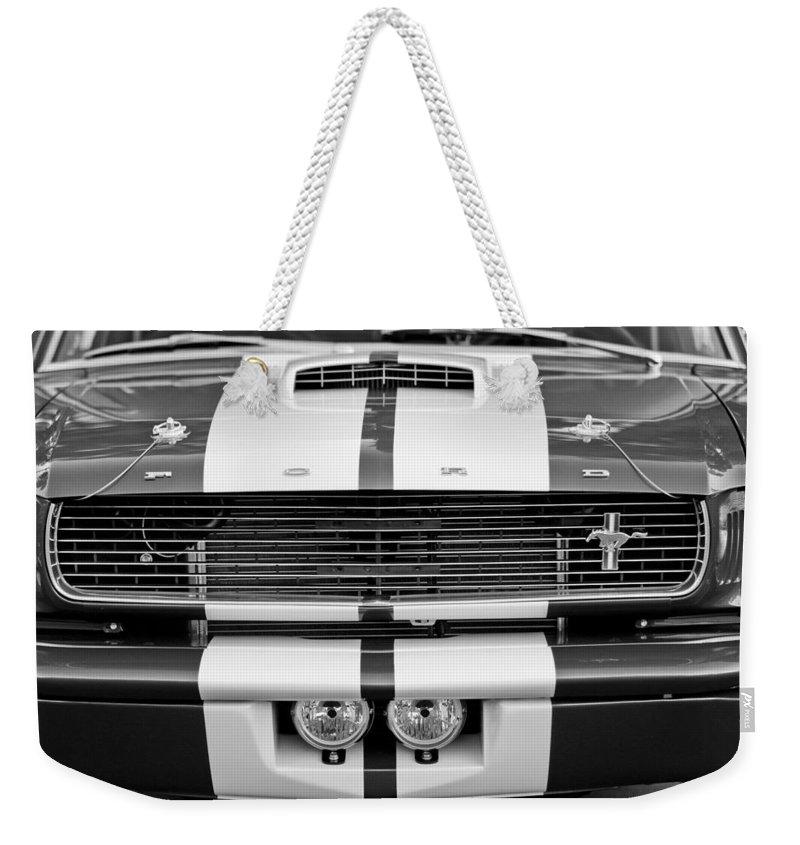 Ford Mustang Grille Emblem Weekender Tote Bag featuring the photograph Ford Mustang Grille Emblem by Jill Reger