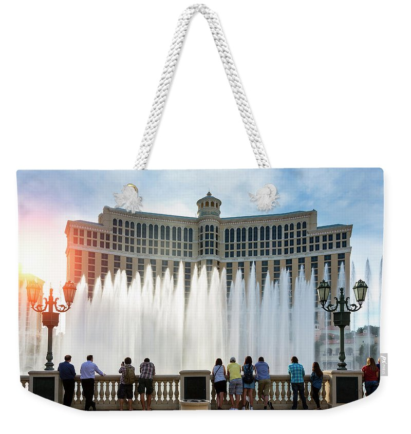 People Weekender Tote Bag featuring the photograph Fountains Of Bellagio, Bellagio Resort by Sylvain Sonnet