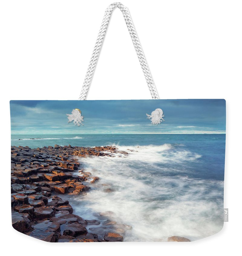 Water's Edge Weekender Tote Bag featuring the photograph Giants Causeway On A Cloudy Day by Mammuth
