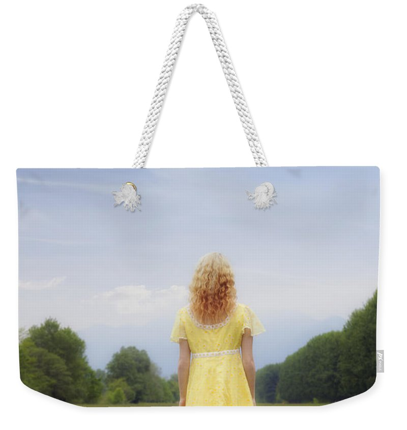 Woman Weekender Tote Bag featuring the photograph Girl On Meadow by Joana Kruse
