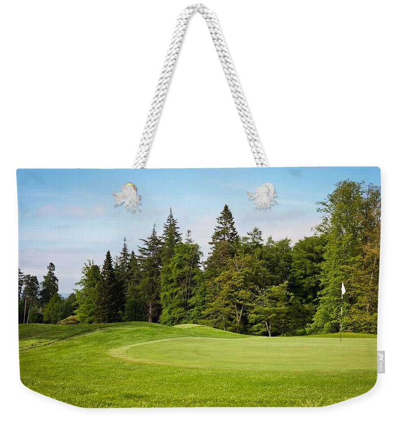 Agricultural Weekender Tote Bag featuring the photograph Golf Course by Tom Gowanlock