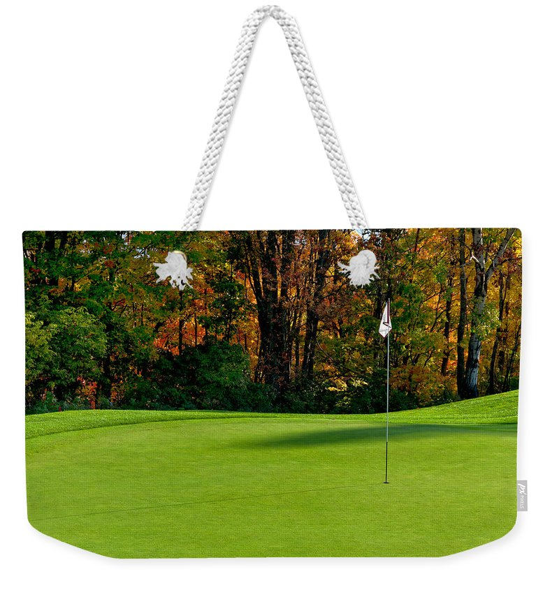 Golf Club Weekender Tote Bag featuring the photograph Golf Tee by U Schade
