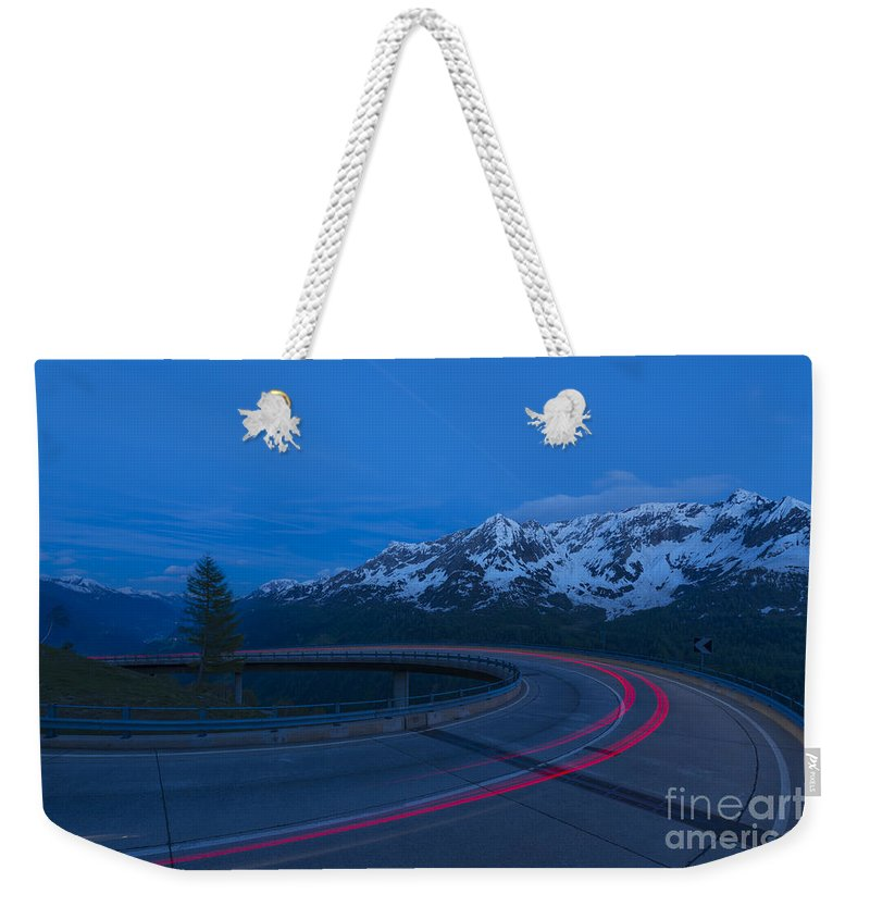 Hairpin Turn Weekender Tote Bag featuring the photograph Hairpin Turn by Mats Silvan