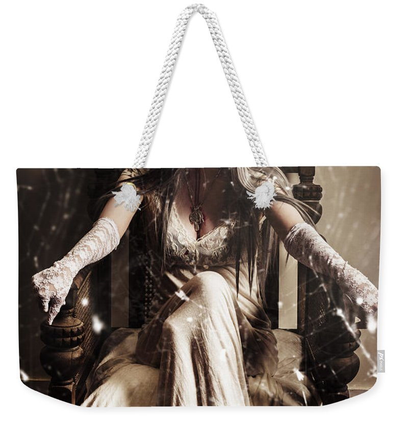 Evil Weekender Tote Bag featuring the photograph Haunting Horror Scene With A Strange Vampire Girl by Jorgo Photography - Wall Art Gallery