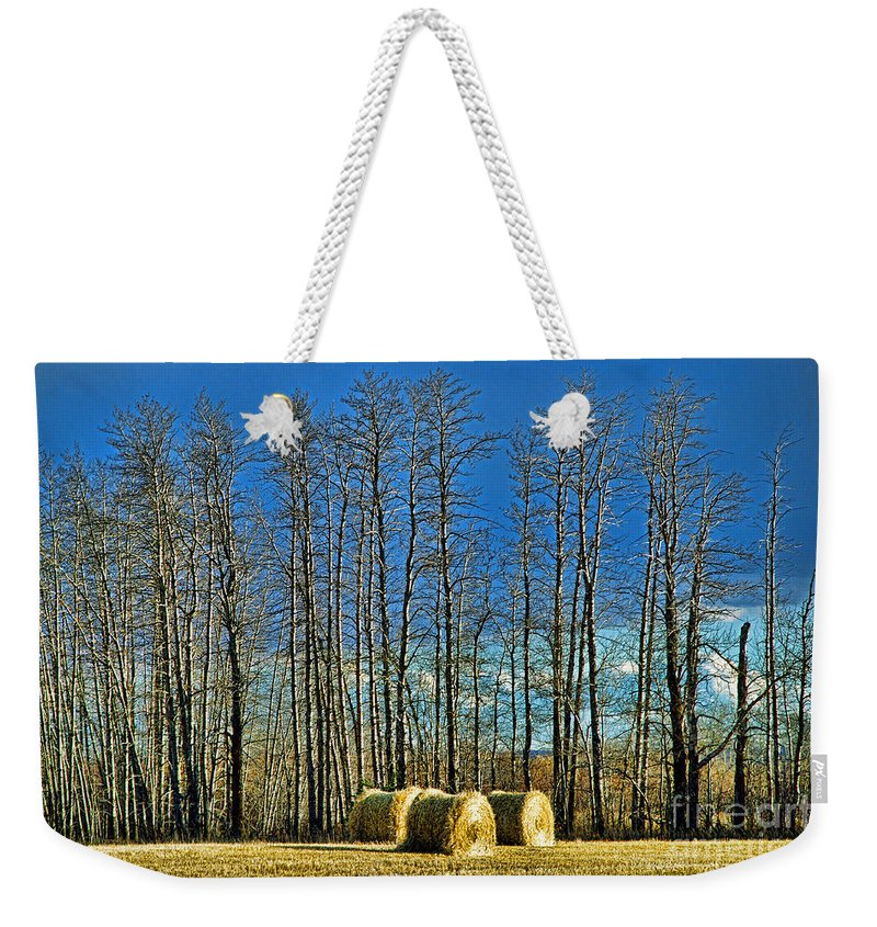 Hay Weekender Tote Bag featuring the photograph Hay Bails by Randy Harris