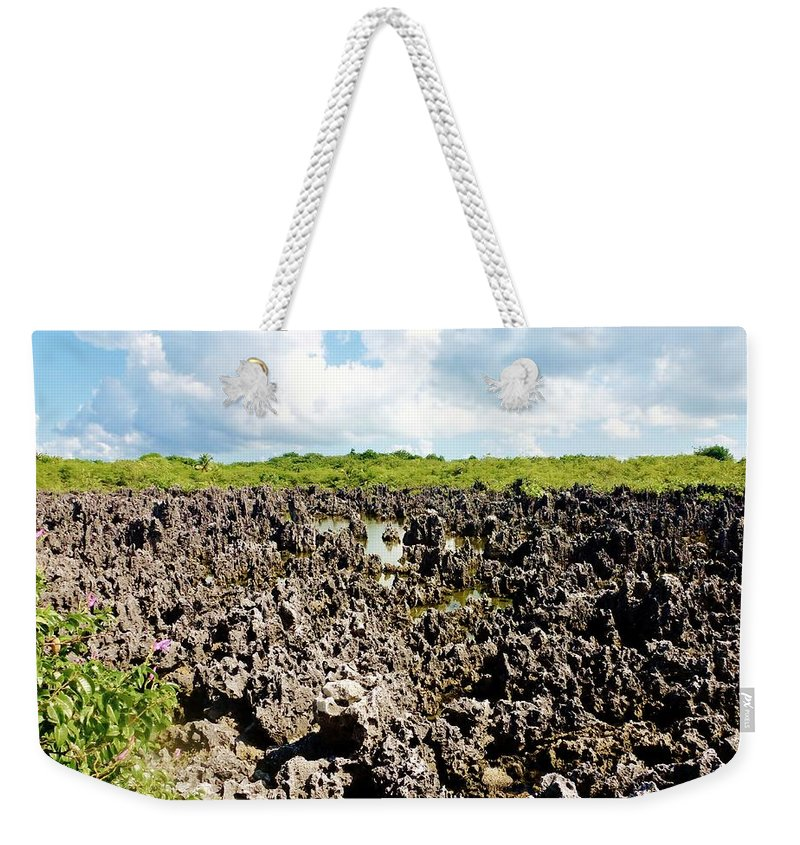 Color Weekender Tote Bag featuring the photograph Hell by Amar Sheow
