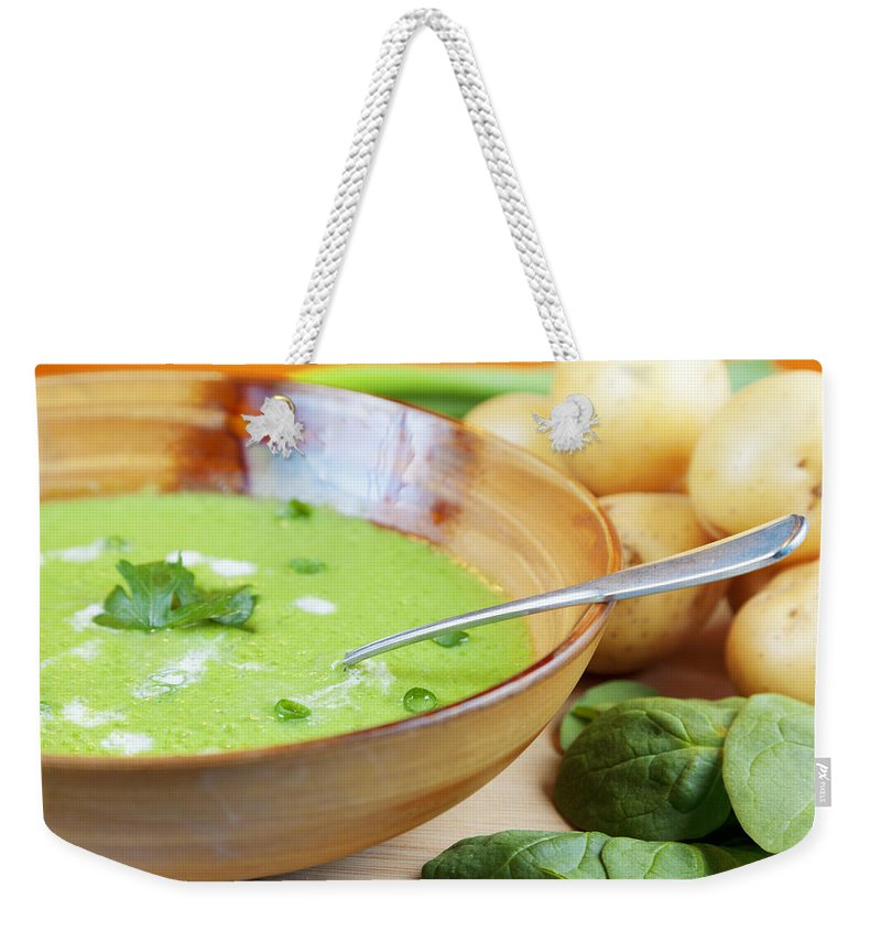 Soup Weekender Tote Bag featuring the photograph Homemade Potato And Spinach Soup by Alexey Stiop