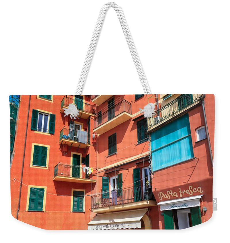 Ancient Weekender Tote Bag featuring the photograph homes and promenade in Camogli by Antonio Scarpi