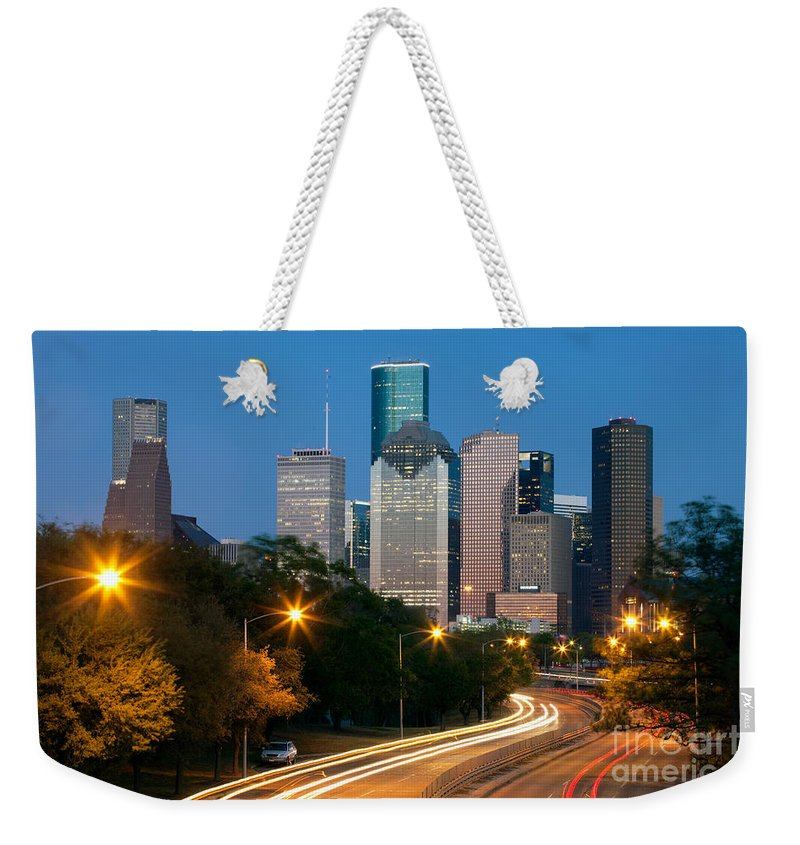 Houston Weekender Tote Bag featuring the photograph Houston Skyline At Dusk by Bill Cobb