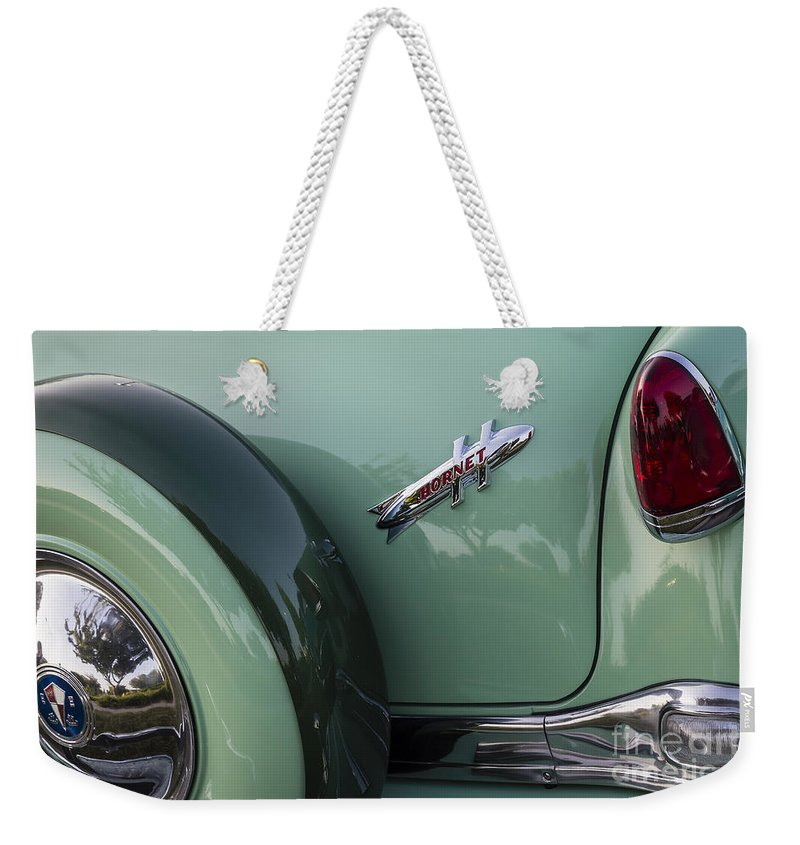 1954 Hudson Weekender Tote Bag featuring the photograph Hudson Hornet by Dennis Hedberg