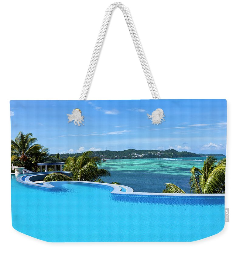 Scenics Weekender Tote Bag featuring the photograph Infinity Swimming Pool by 35007