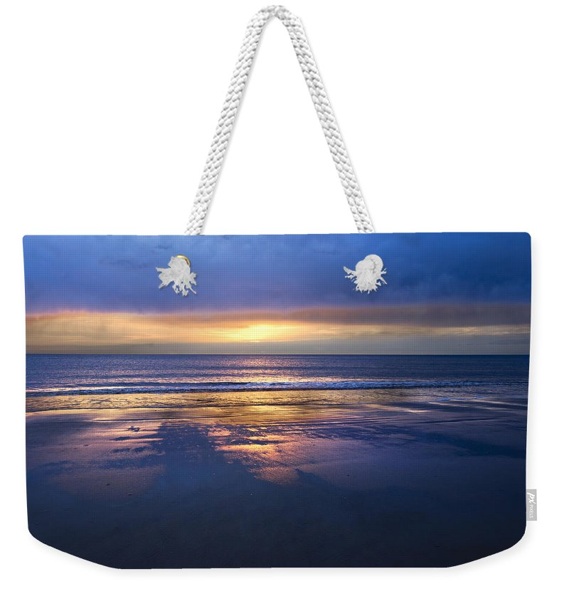 Clouds Weekender Tote Bag featuring the photograph Into The Light by Debra and Dave Vanderlaan