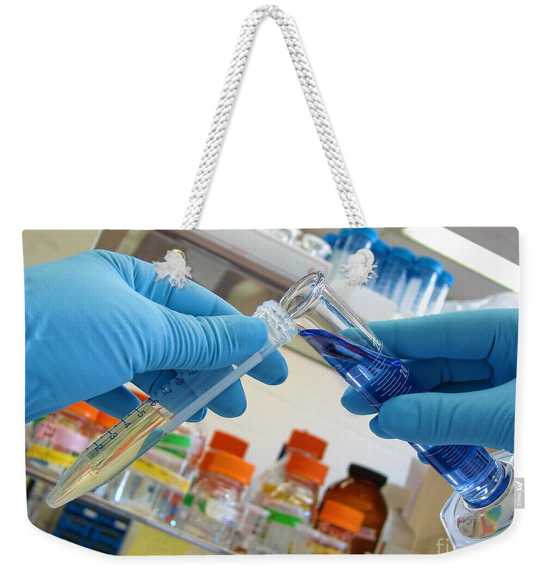 Analysis Weekender Tote Bag featuring the photograph Laboratory Experiment In Science Research Lab by Olivier Le Queinec