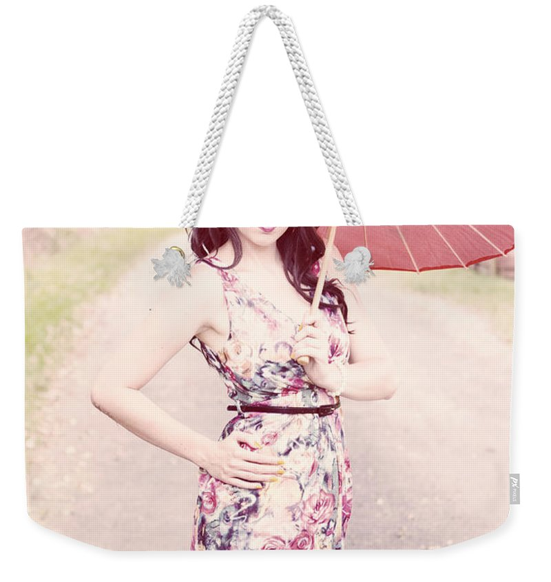Bright Weekender Tote Bag featuring the photograph Lady With Red Parasol by Jorgo Photography - Wall Art Gallery