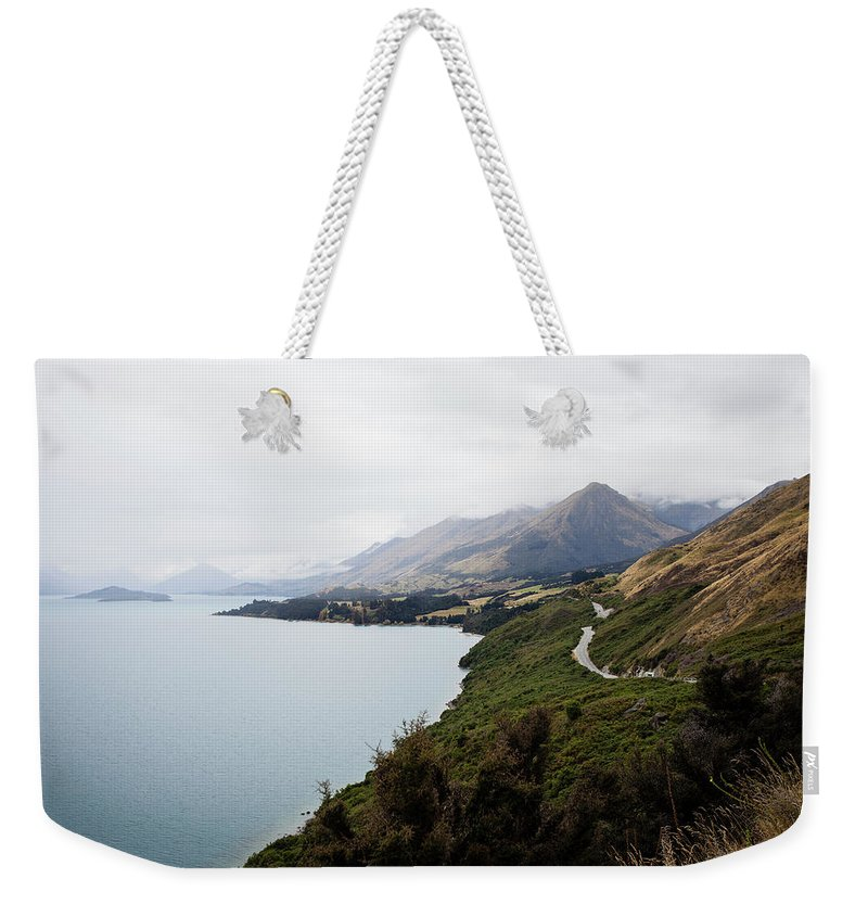Tranquility Weekender Tote Bag featuring the photograph Lake Wakatipu by Claire Takacs