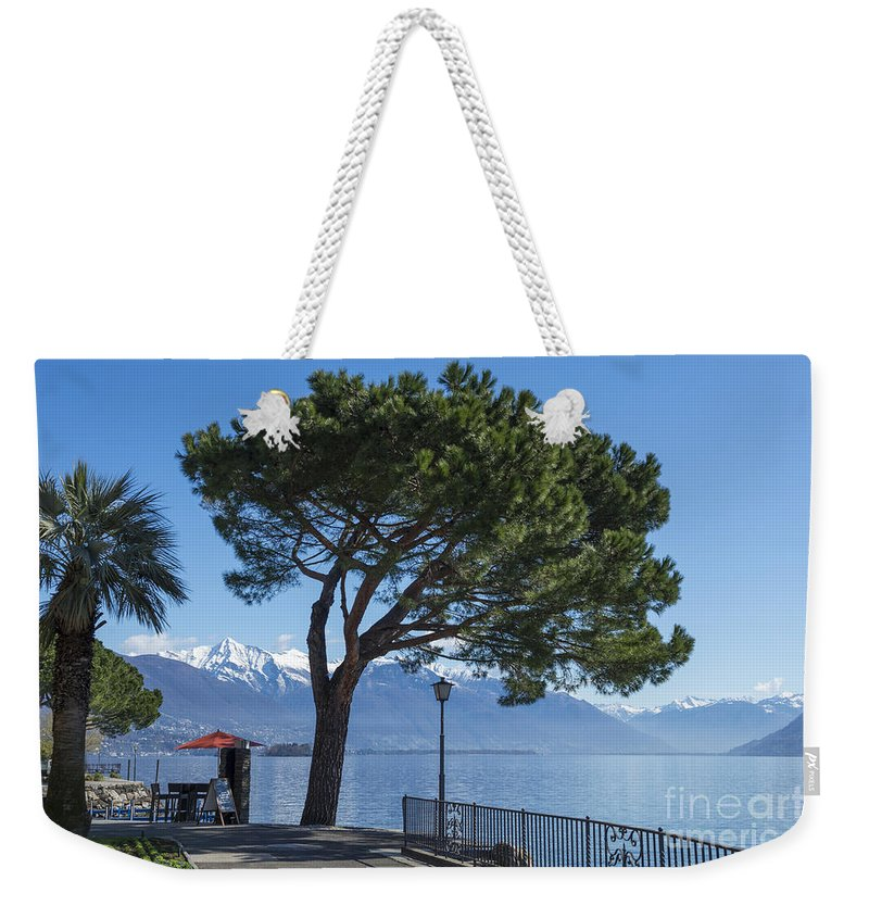 Street Weekender Tote Bag featuring the photograph Lakeside With Trees by Mats Silvan