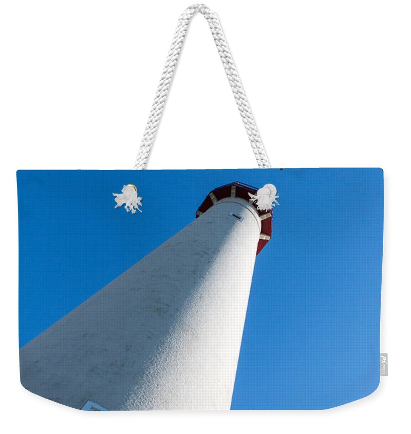 Blue Weekender Tote Bag featuring the photograph Lighthouse by Gaurav Singh