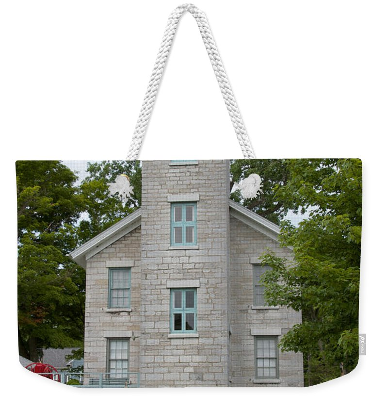 Sodus Weekender Tote Bag featuring the photograph Lighthouse by William Norton