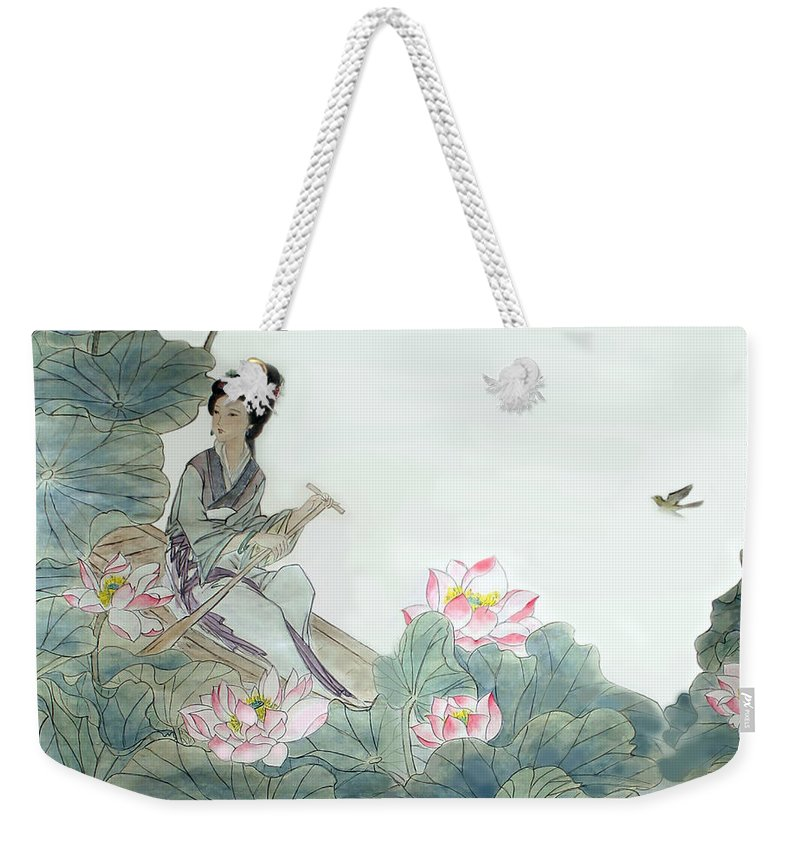 Lotus Flowers Weekender Tote Bag featuring the photograph Lotus Pond by Yufeng Wang