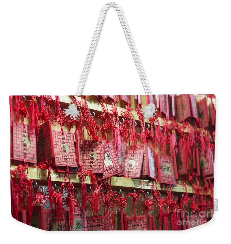 Asia Weekender Tote Bag featuring the photograph Lucky Wishes In Chinese Temple by Jacek Malipan