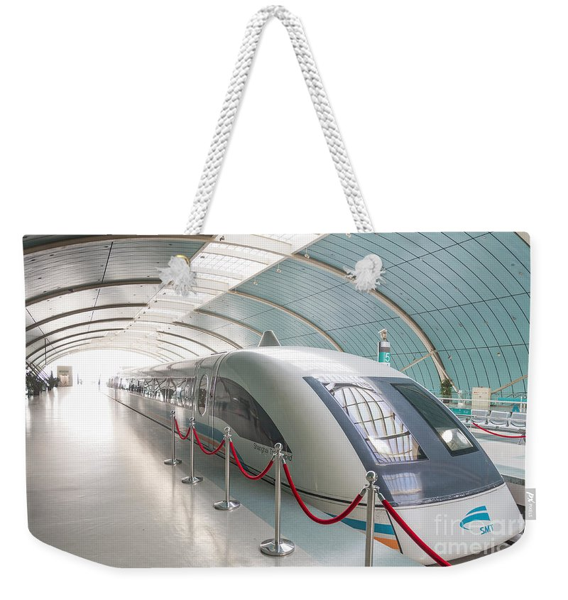 Architecture Weekender Tote Bag featuring the photograph Maglev Train In Shanghai China by Jacek Malipan