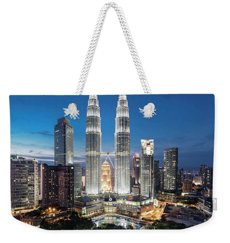 Downtown District Weekender Tote Bag featuring the photograph Malaysia, Kuala Lumpur, Petronas Towers by Martin Puddy