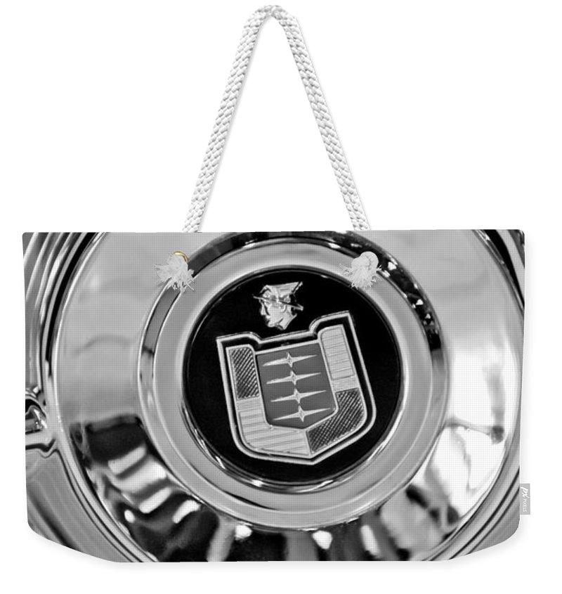 Mercury Wheel Emblem Weekender Tote Bag featuring the photograph Mercury Wheel Emblem by Jill Reger