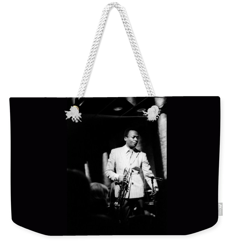 Miles Weekender Tote Bag featuring the photograph Miles Davis At The Penthouse by Dave Coleman
