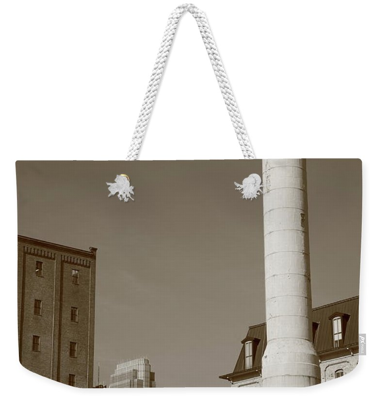 America Weekender Tote Bag featuring the photograph Minneapolis Smokestack by Frank Romeo