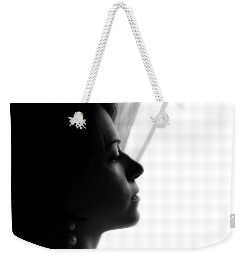 Portrait Photographs Weekender Tote Bag featuring the photograph Nancy by Andrea Mazzocchetti