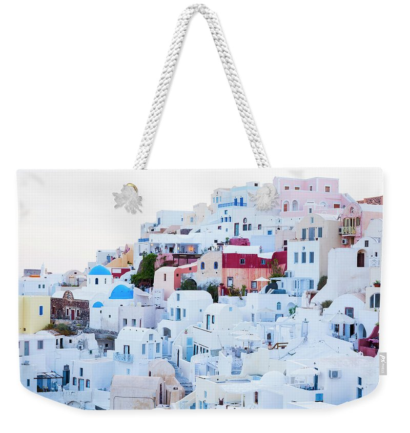 Tranquility Weekender Tote Bag featuring the photograph Oia by Jorg Greuel