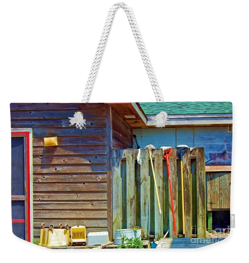 Building Weekender Tote Bag featuring the photograph Out To Dry by Debbi Granruth