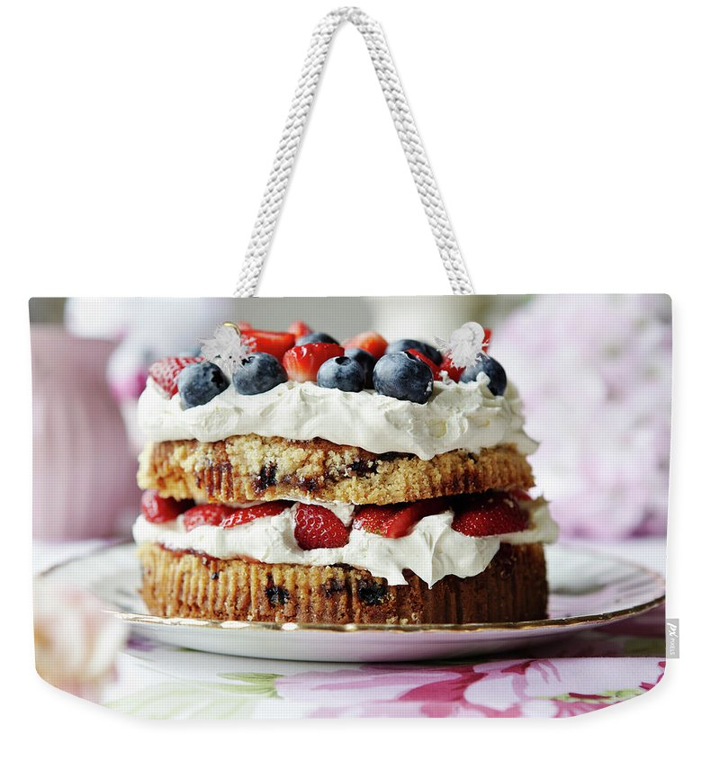 West Yorkshire Weekender Tote Bag featuring the photograph Plate Of Fruit And Cream Cake by Debby Lewis-harrison