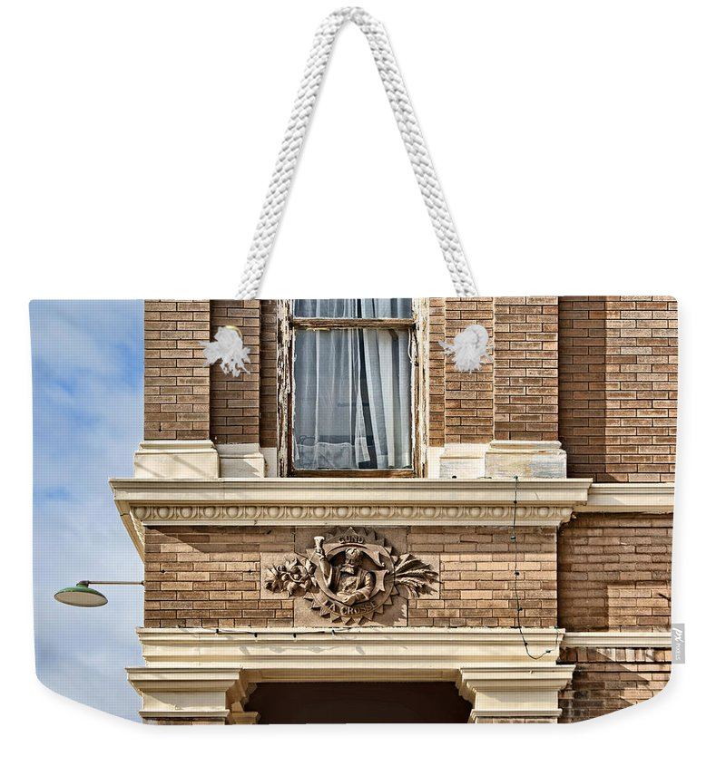 Cartouche Weekender Tote Bag featuring the photograph Plattsmouth Corner by Nikolyn McDonald
