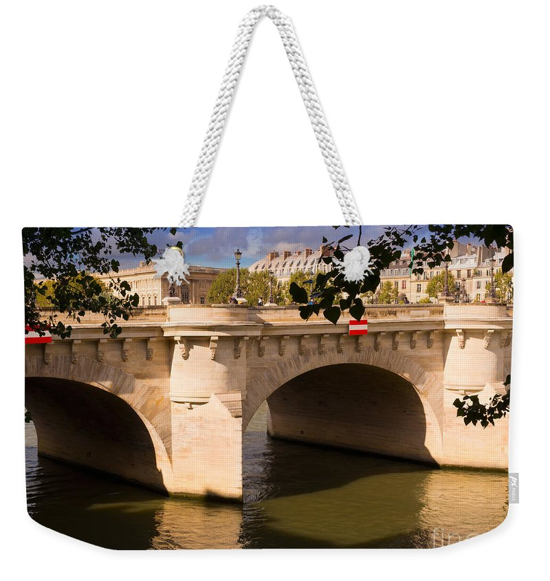 Pont Neuf Weekender Tote Bag featuring the photograph Pont Neuf Over The Seine River Paris by Louise Heusinkveld