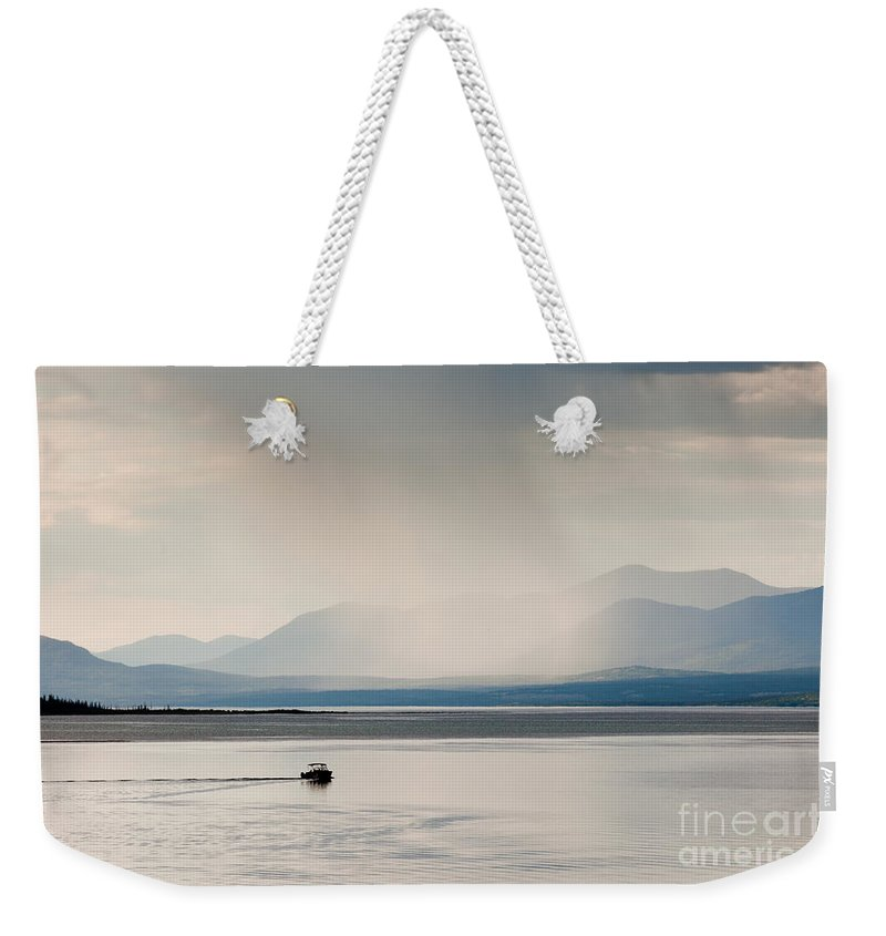 Adventure Weekender Tote Bag featuring the photograph Rain Shower Over Marsh Lake Yukon Territory Canda by Stephan Pietzko