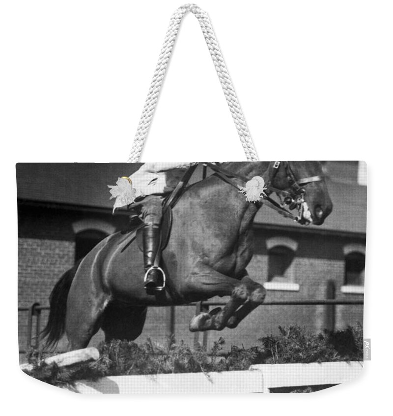 1927 Weekender Tote Bag featuring the photograph Rider Jumps At Horse Show by Underwood Archives