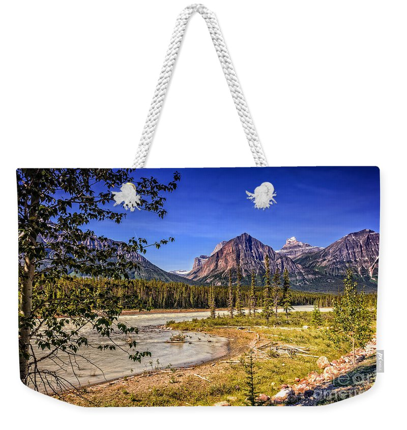 River Weekender Tote Bag featuring the photograph River And Mountains In Jasper by Viktor Birkus