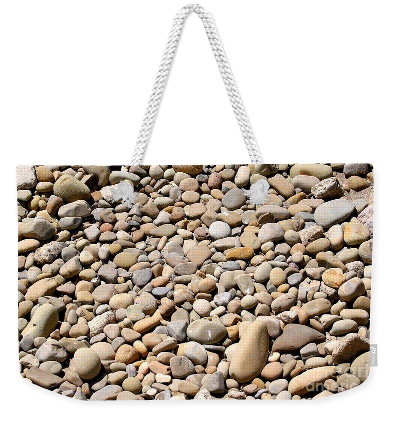 Stone Weekender Tote Bag featuring the photograph River Rocks Pebbles by Henrik Lehnerer