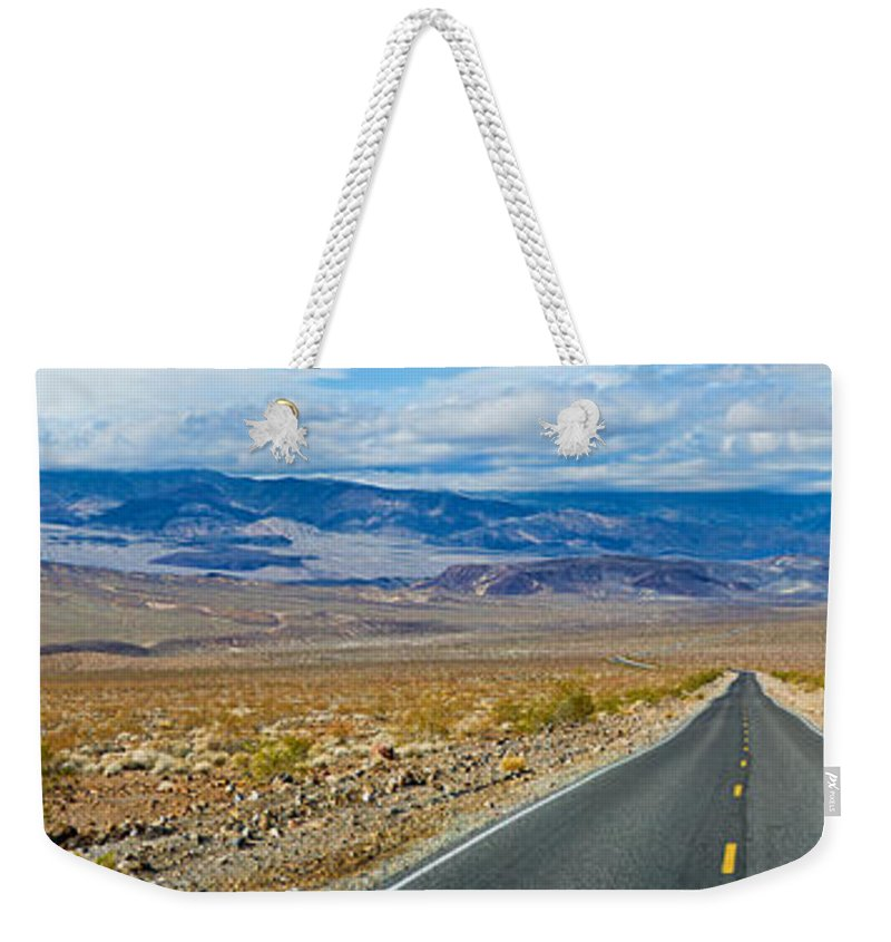 Photography Weekender Tote Bag featuring the photograph Road Passing Through A Desert, Death by Panoramic Images
