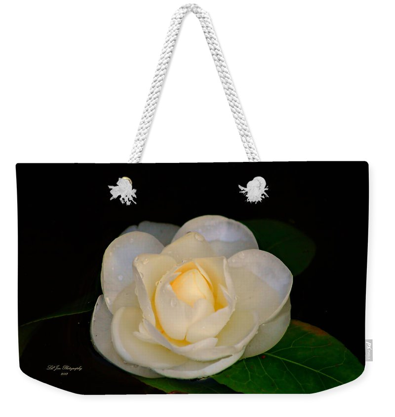 Magnolia Weekender Tote Bag featuring the photograph Romance In Bloom by Jeanette C Landstrom