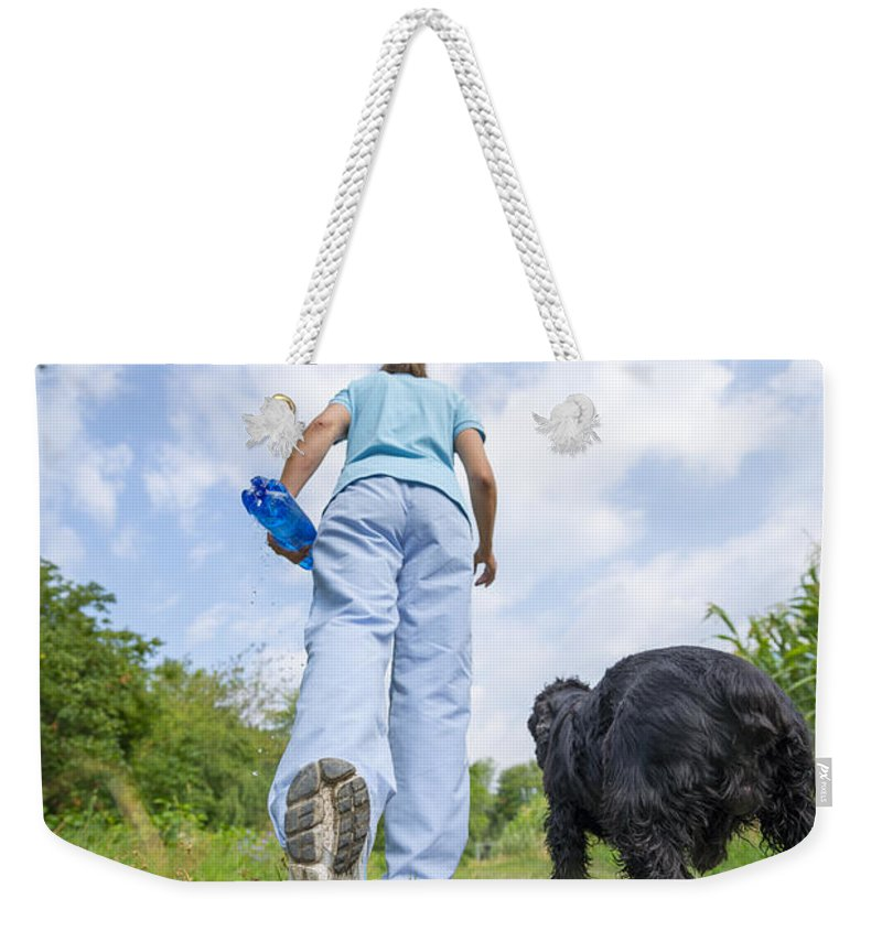 Woman Weekender Tote Bag featuring the photograph Running by Mats Silvan