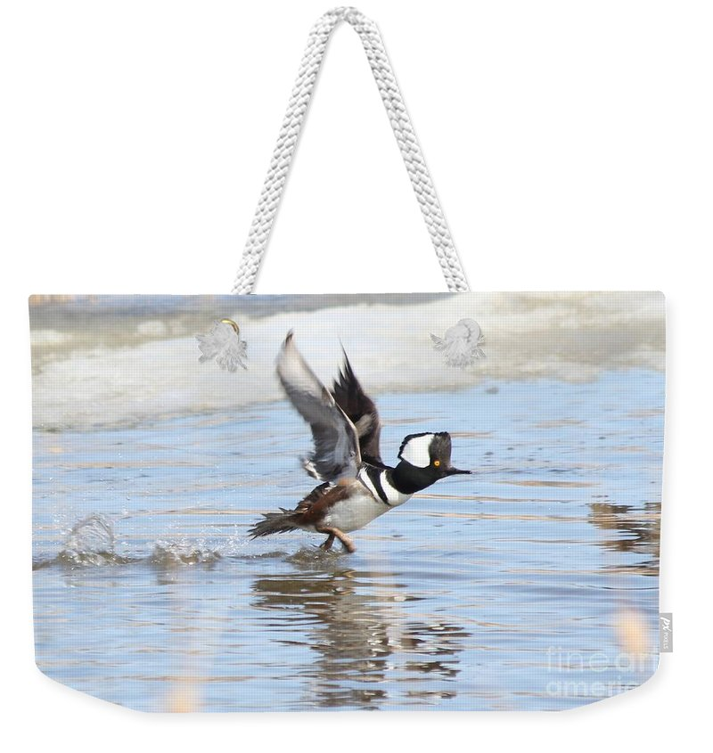 Hodded Weekender Tote Bag featuring the photograph Running On The Water by Lori Tordsen