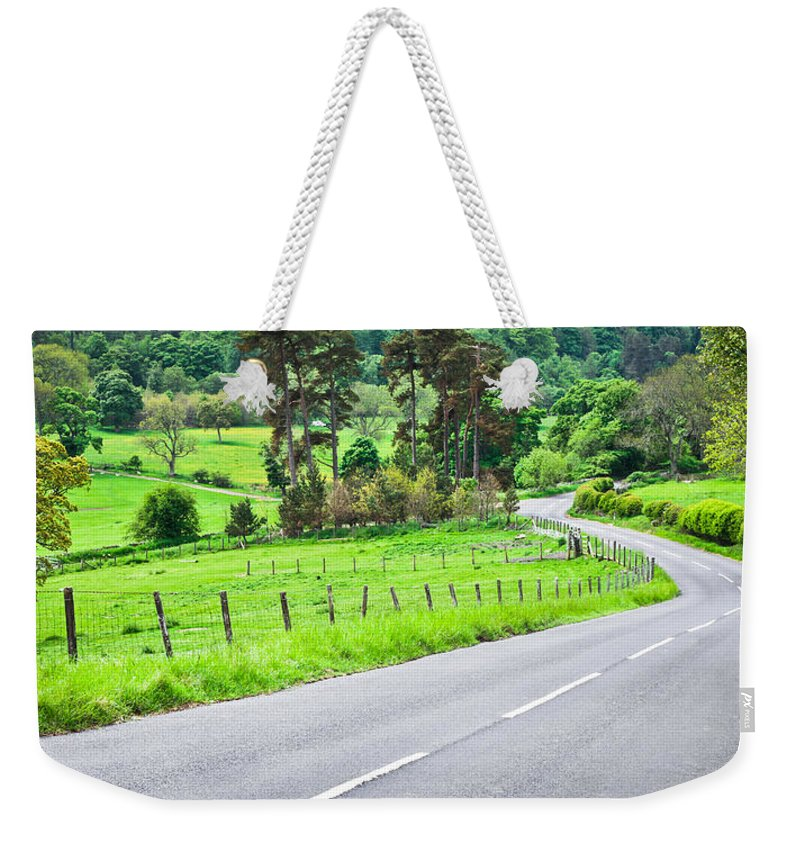 Beautiful Weekender Tote Bag featuring the photograph Rural Road by Tom Gowanlock