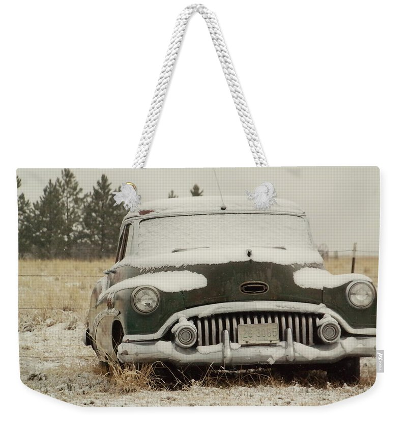 Cars Weekender Tote Bag featuring the photograph Rusting In The Snow by Jeff Swan