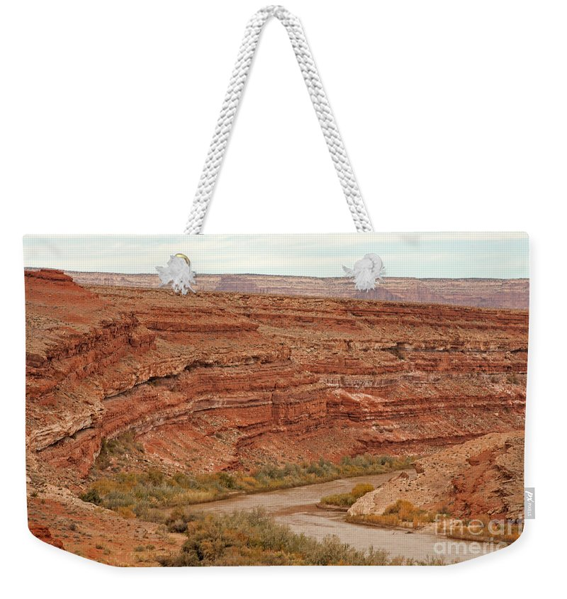 Autumn Weekender Tote Bag featuring the photograph San Juan River by Fred Stearns